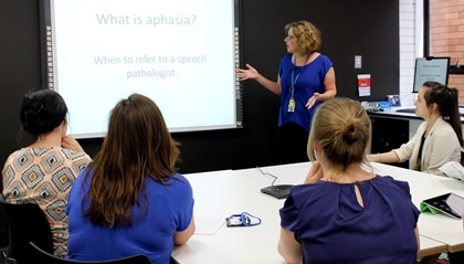 speech pathologist providing training for other professionals